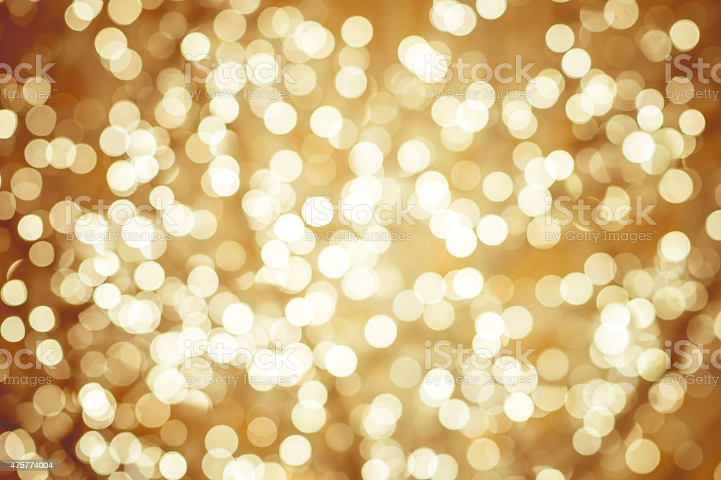Golden background with natural bokeh defocused sparkling lights stock photo
