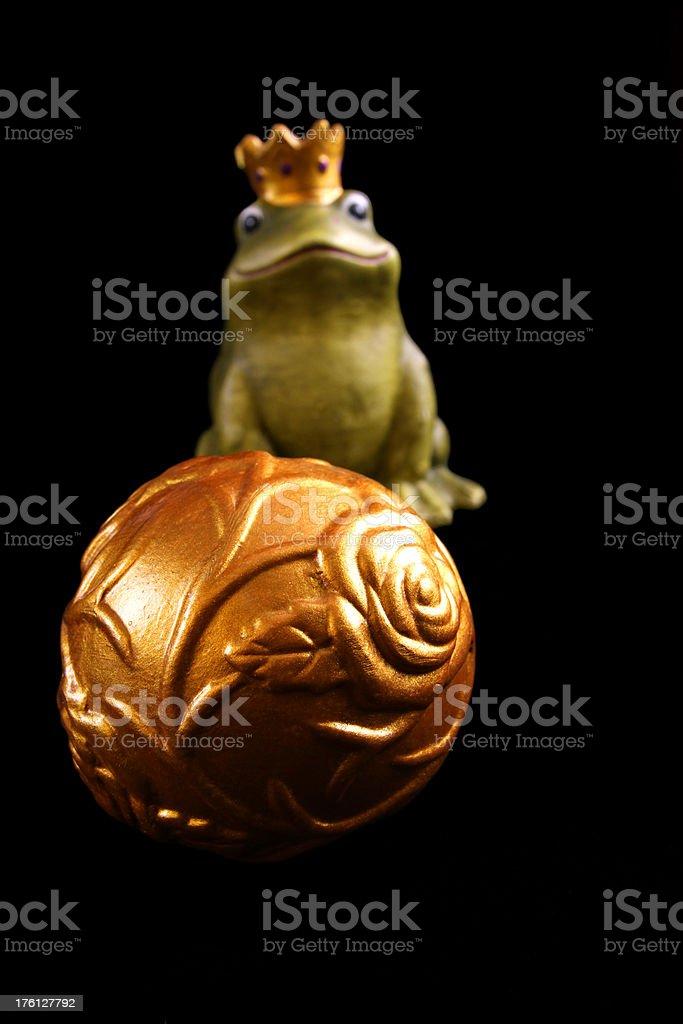 golden ball and frog prince stock photo
