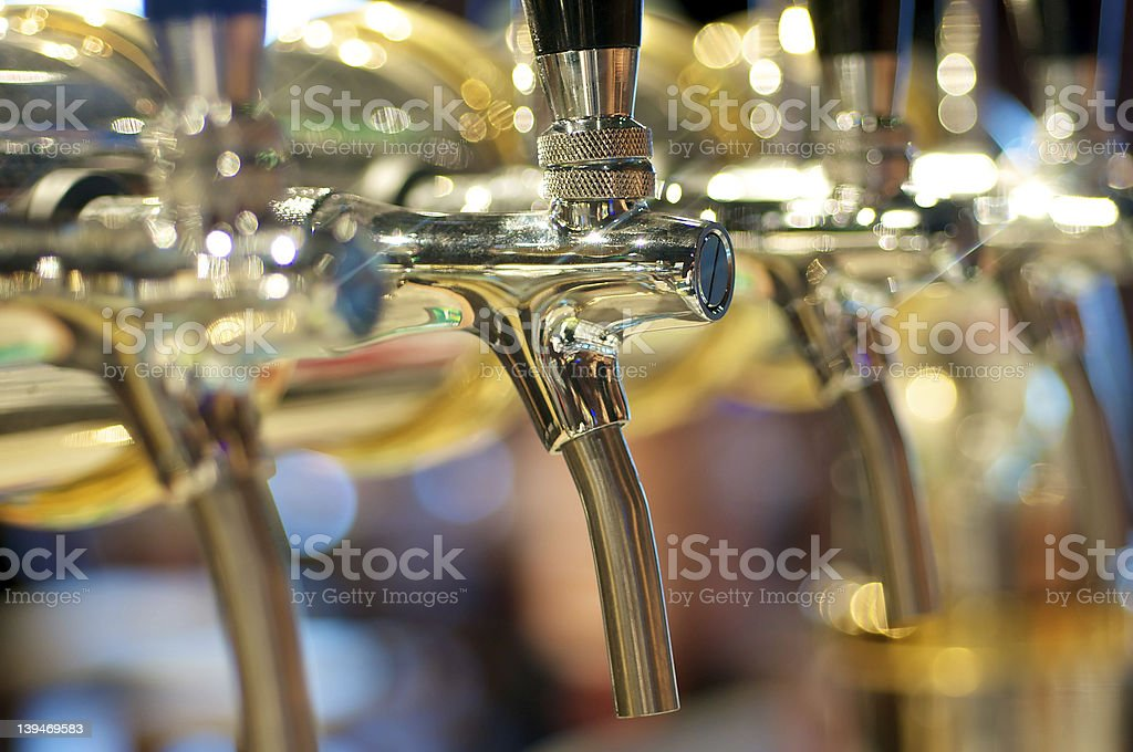 Golden Beer Taps royalty-free stock photo