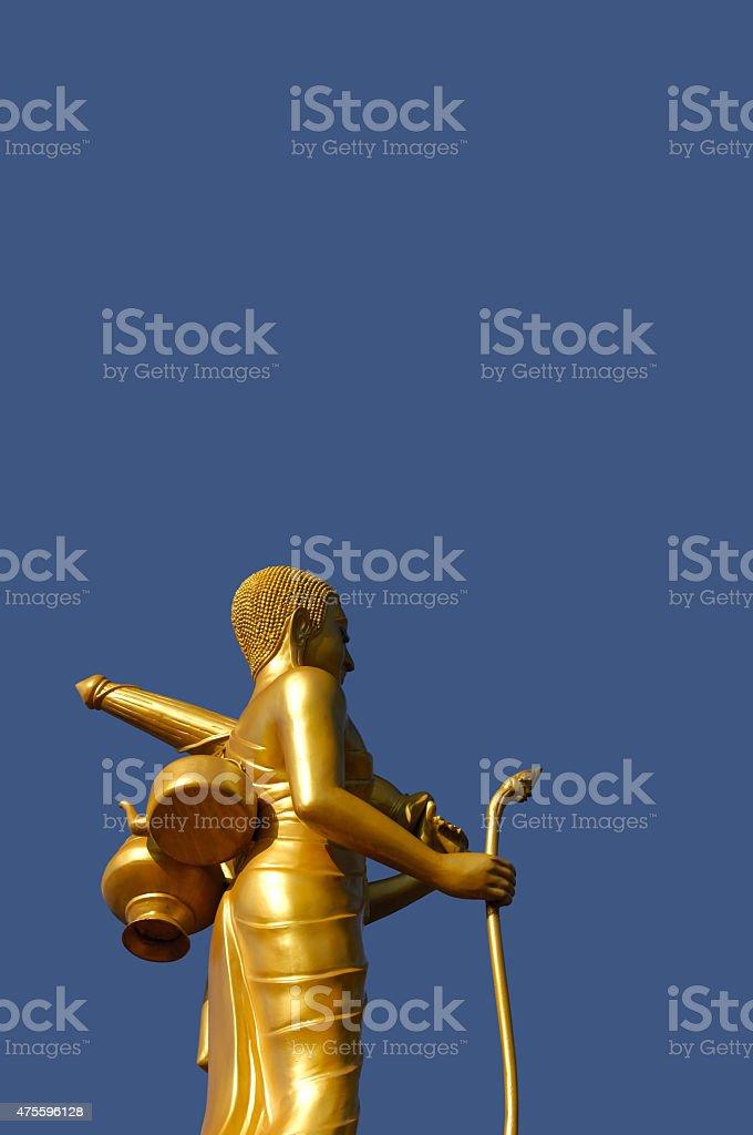 Golden bodhisattva under blue sky stock photo