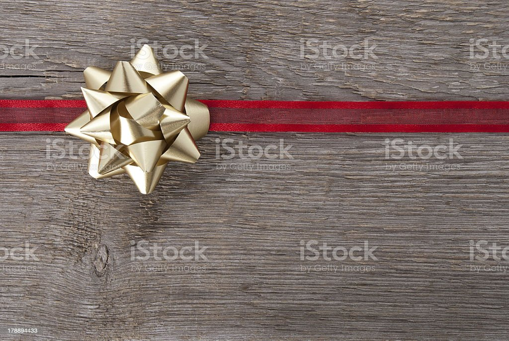 golden bow on red ribbon stock photo