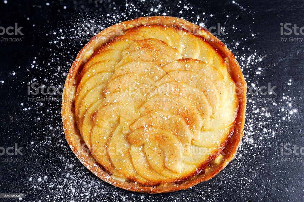 Golden Bramley apple tart with cinnamon glaze stock photo