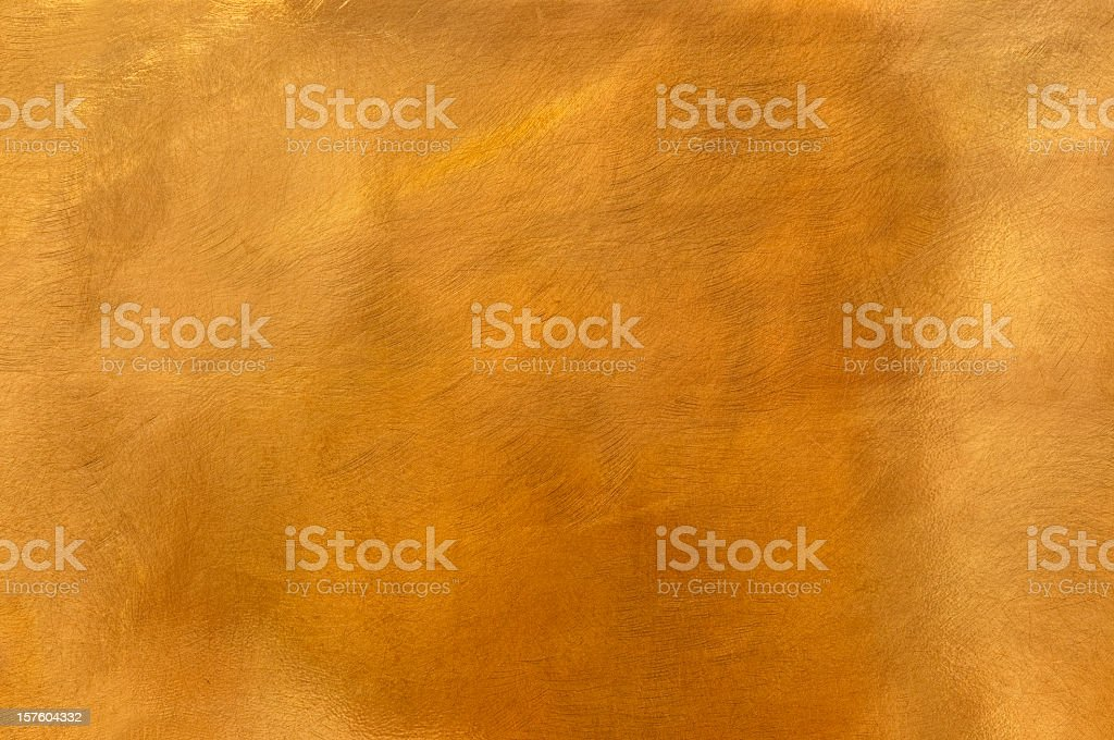 Golden brass metal plate background textured surface XL stock photo