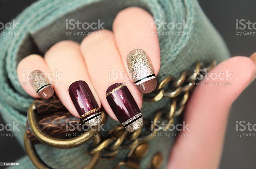 Golden brown French manicure. stock photo