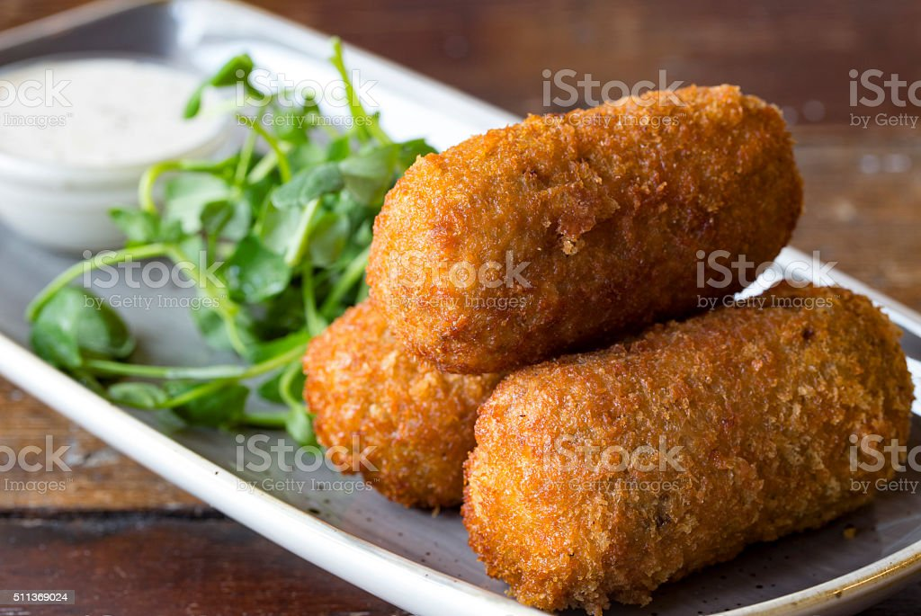 Golden brown mouthwatering Croquettes or croquetas stock photo