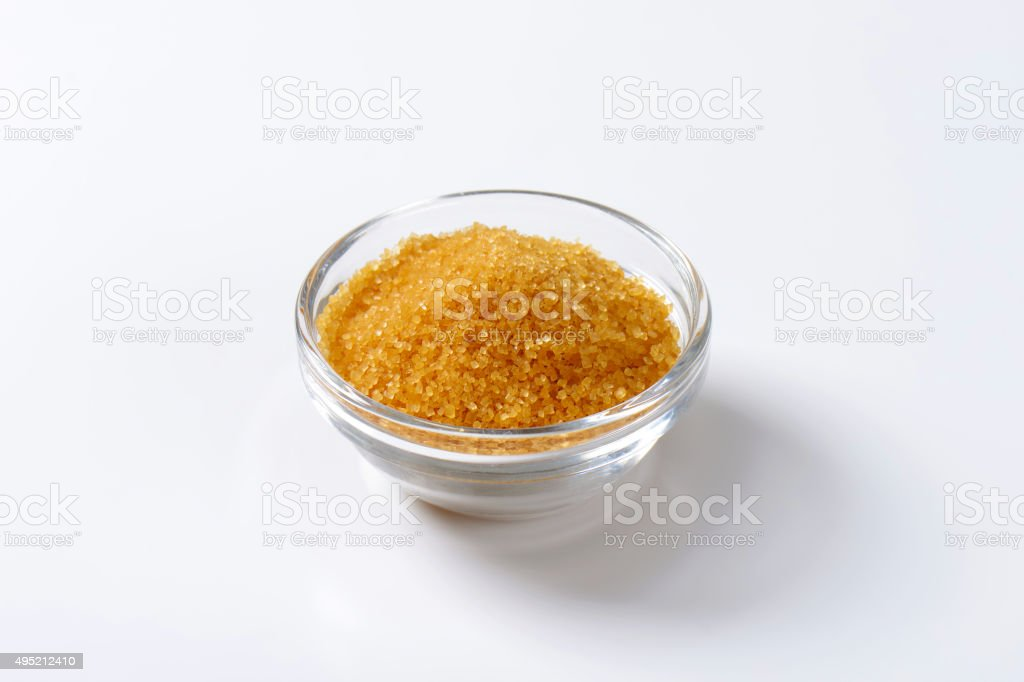 Golden brown raw cane sugar stock photo