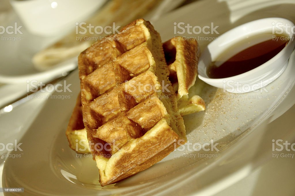 Golden brown waffle with maple syrup stock photo
