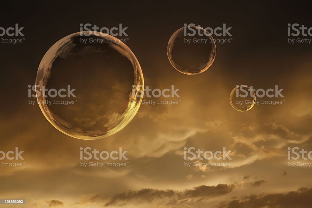 Golden Bubbles Float Against Beautiful Clouds of Clearing Storm royalty-free stock photo