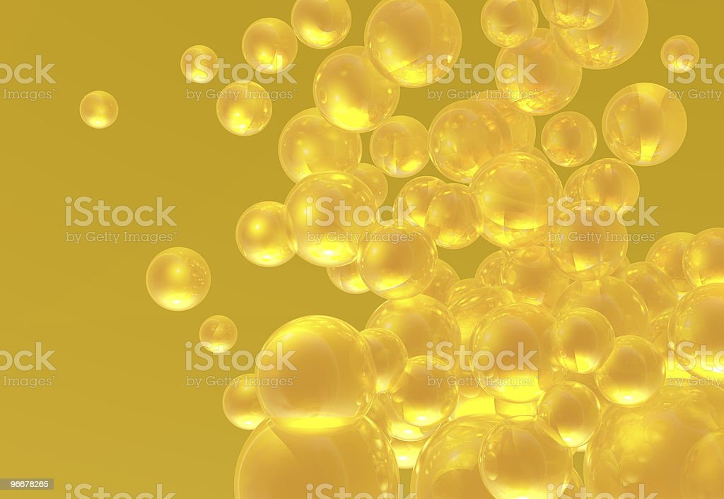 Golden bubbles on a gold background stock photo