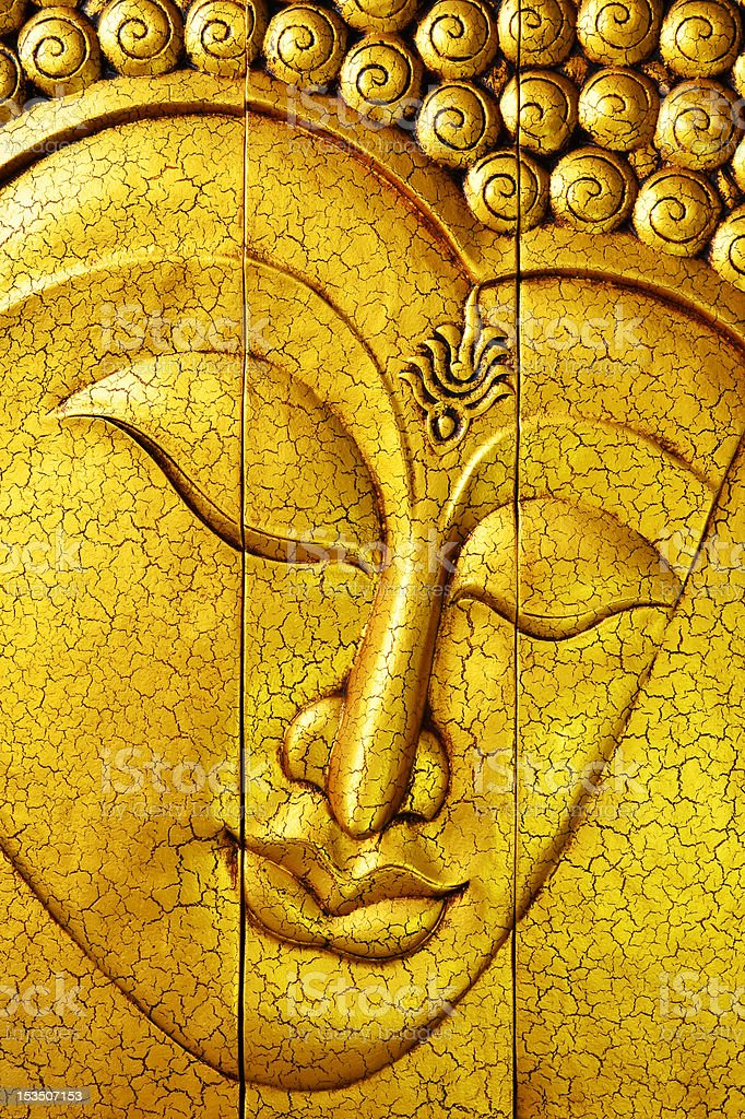 Golden Buddha Face Made by Carving Wood royalty-free stock photo