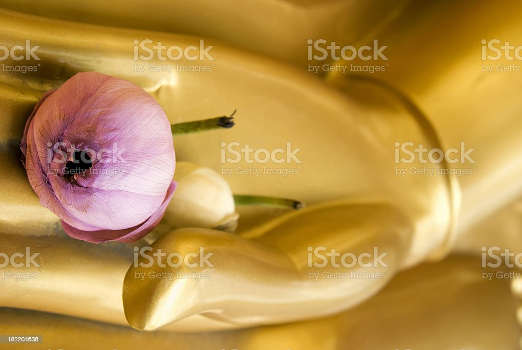 Golden Buddha sculpture with lotus flower royalty-free stock photo