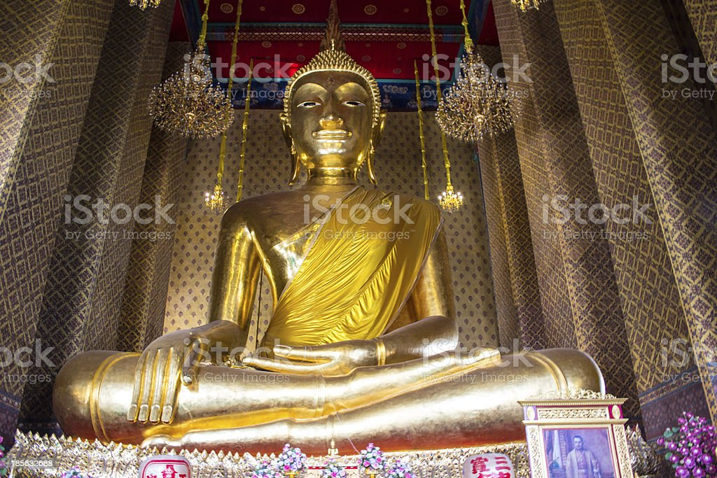 Golden Buddha statue in a Buddhist temple royalty-free stock photo