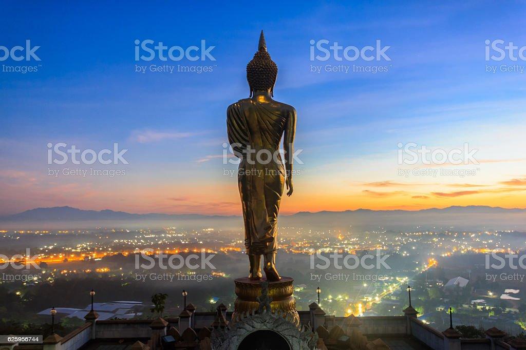 Golden buddha statue in Khao Noi temple stock photo
