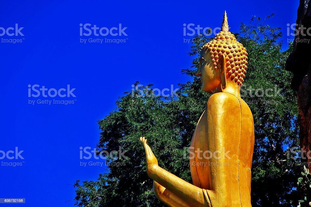Golden Buddha statue in Khao Takiab temple, Thailand stock photo