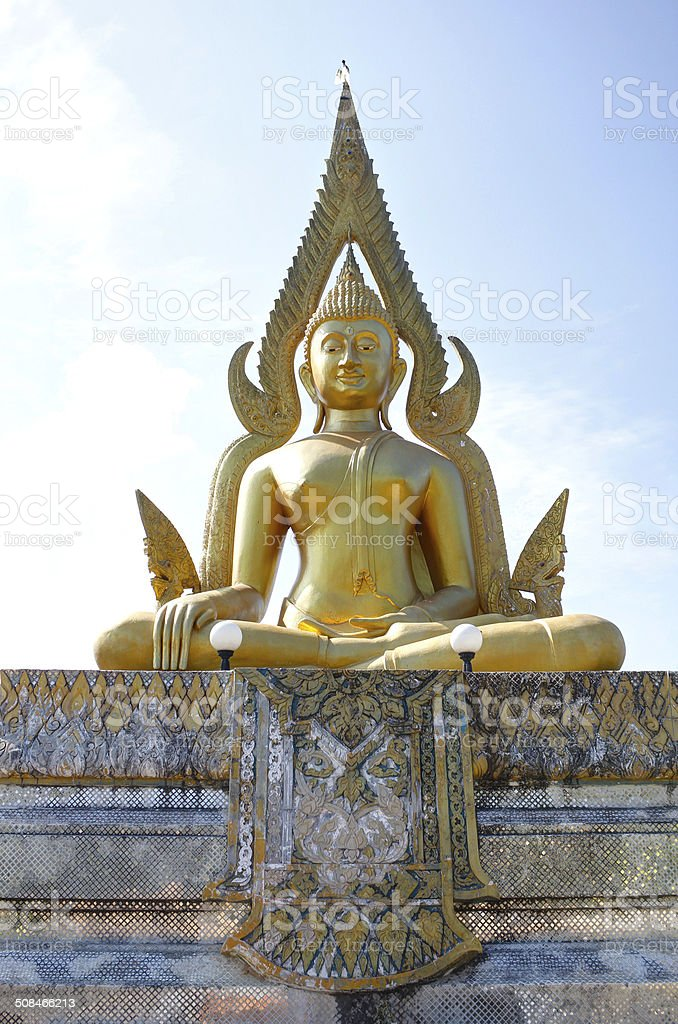 Golden buddha statue in Thailand at the temple. stock photo