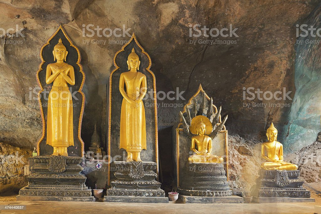 Golden Buddha Statues in Ancient Wat Suwan Kuha Temple royalty-free stock photo