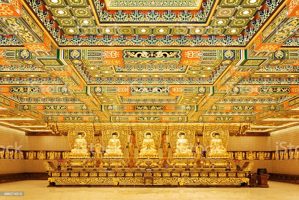 Golden Buddha statues in interior of the Po Lin Monastery stock photo