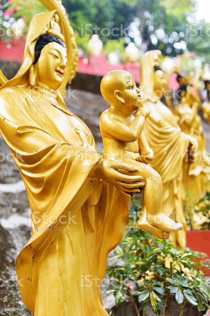 Golden Buddha statues in the Ten Thousand Buddhas Monastery stock photo