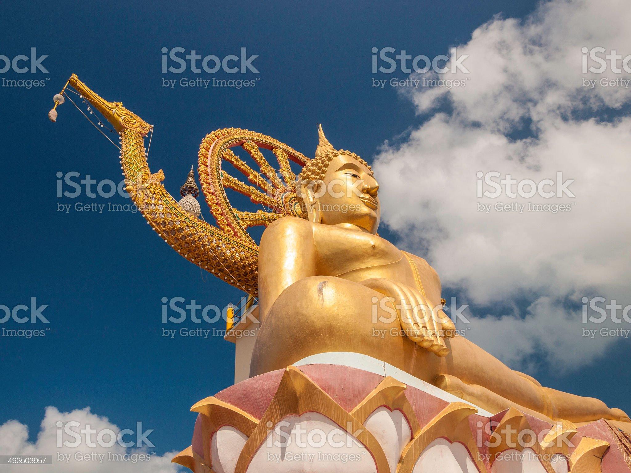 golden Buddha status with blue sky at Ko Samui Thailand royalty-free stock photo