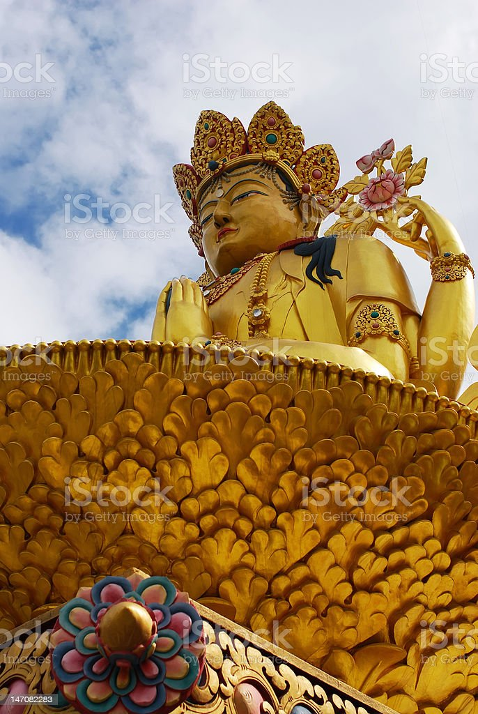 Golden Buddha under blue sky at kathmandu nepal stock photo