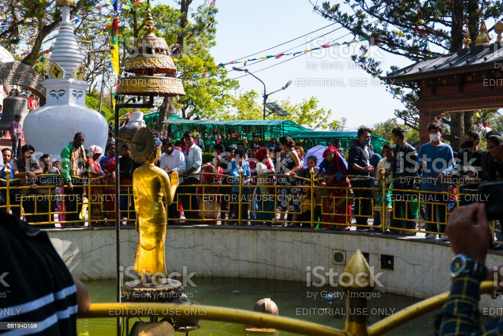 Golden Buddha with people stock photo