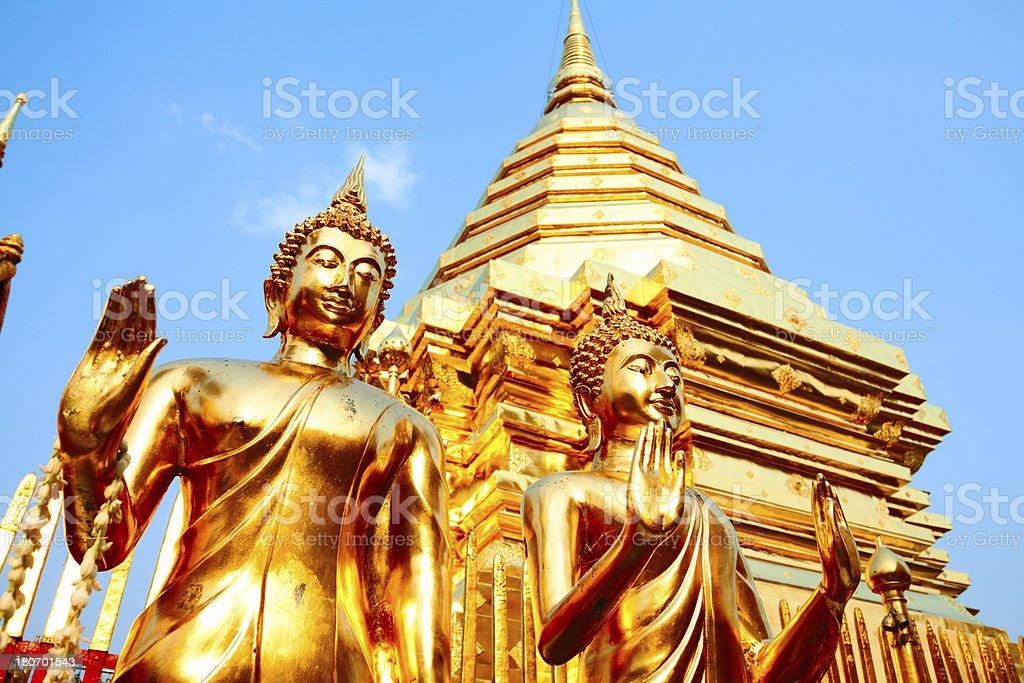 Golden Buddhas and pagoda stock photo