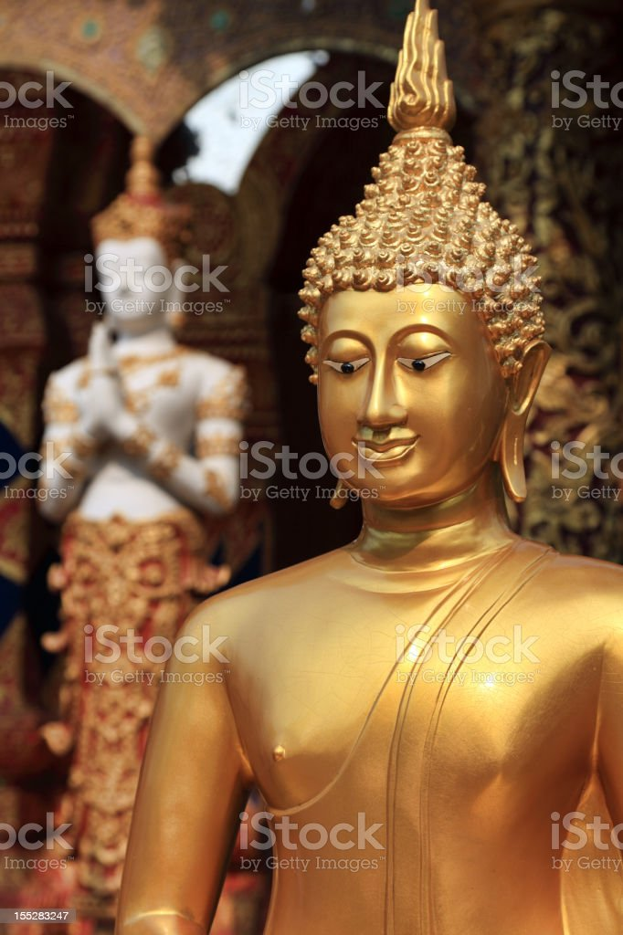 Golden Buddhas in front of the temple Wat Lok Molee royalty-free stock photo