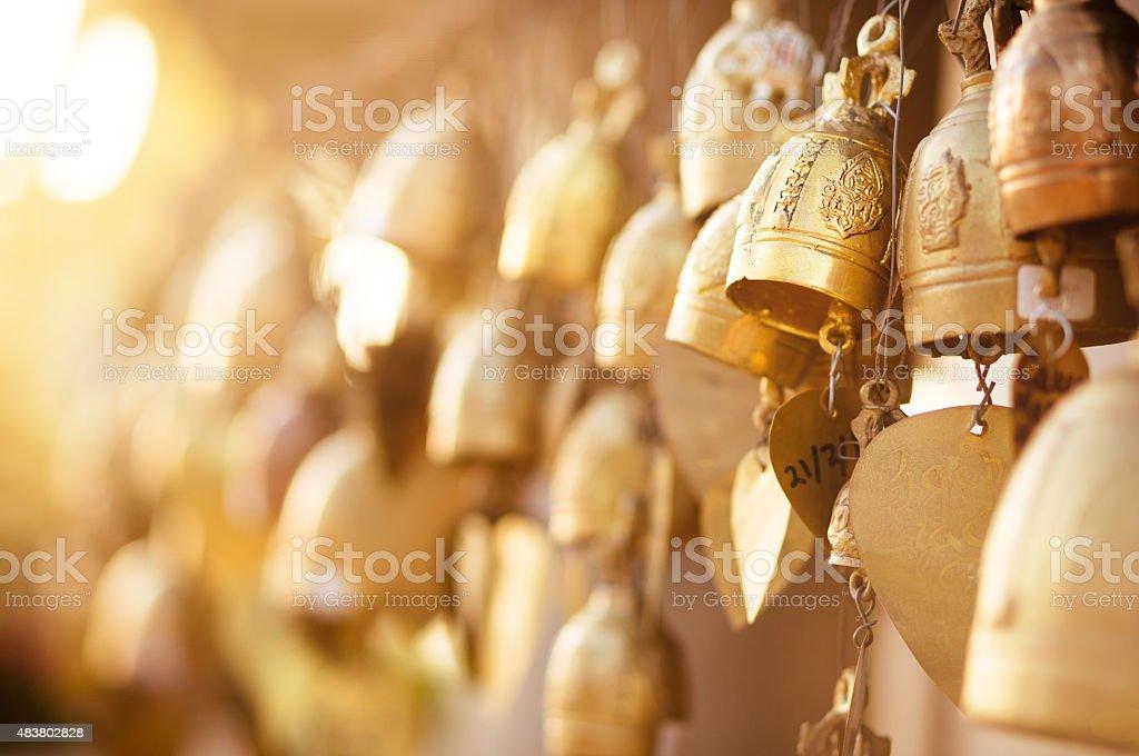Golden buddhist bells stock photo