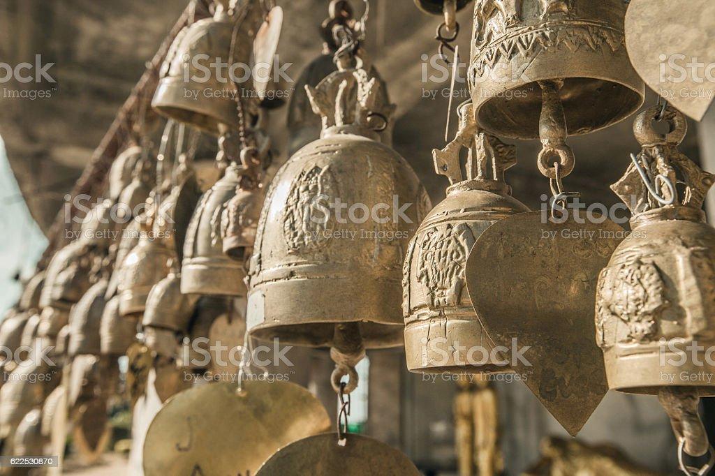 Golden buddhist bells w stock photo