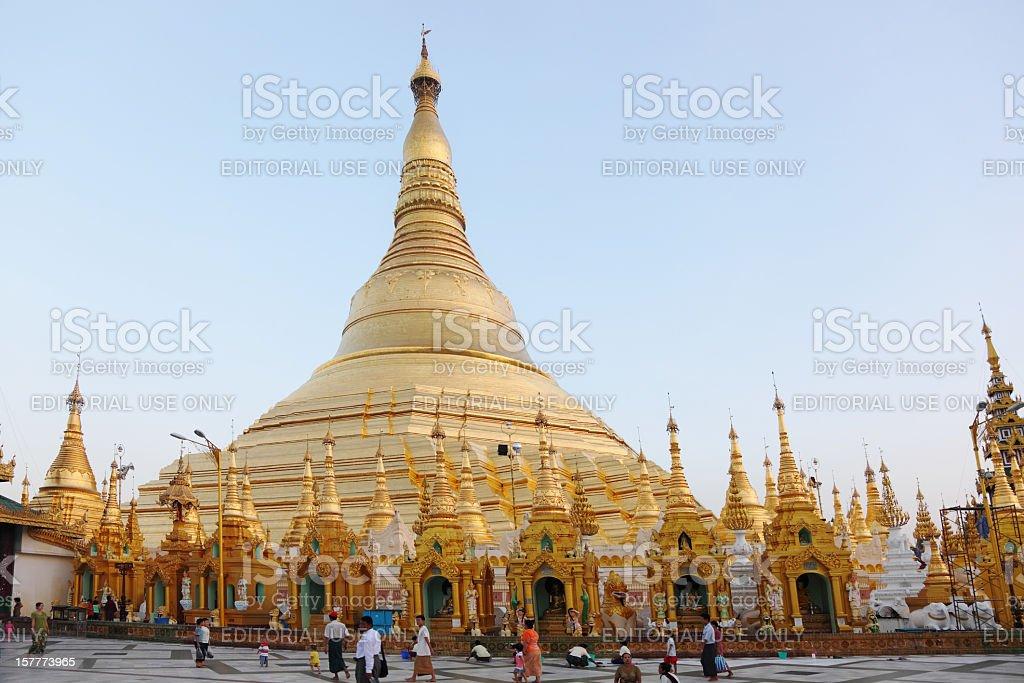 golden buddhist Shwedagon pagoda and praying pilgrims royalty-free stock photo