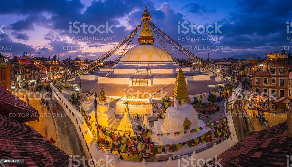 Golden Buddhist stupa illuminated at sunset Boudhanath panorama Kathmandu Nepal stock photo