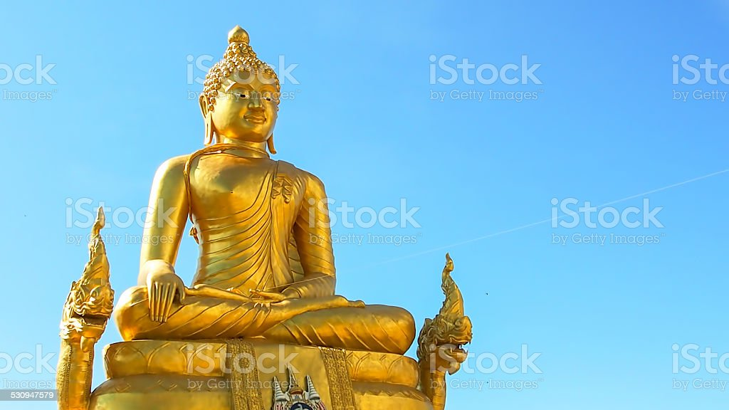 Golden Buggha near Big Buddha stock photo
