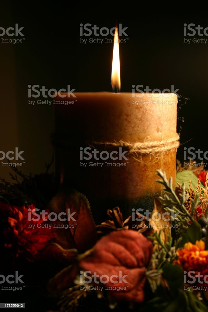 Golden Candle Series (against a black background) royalty-free stock photo