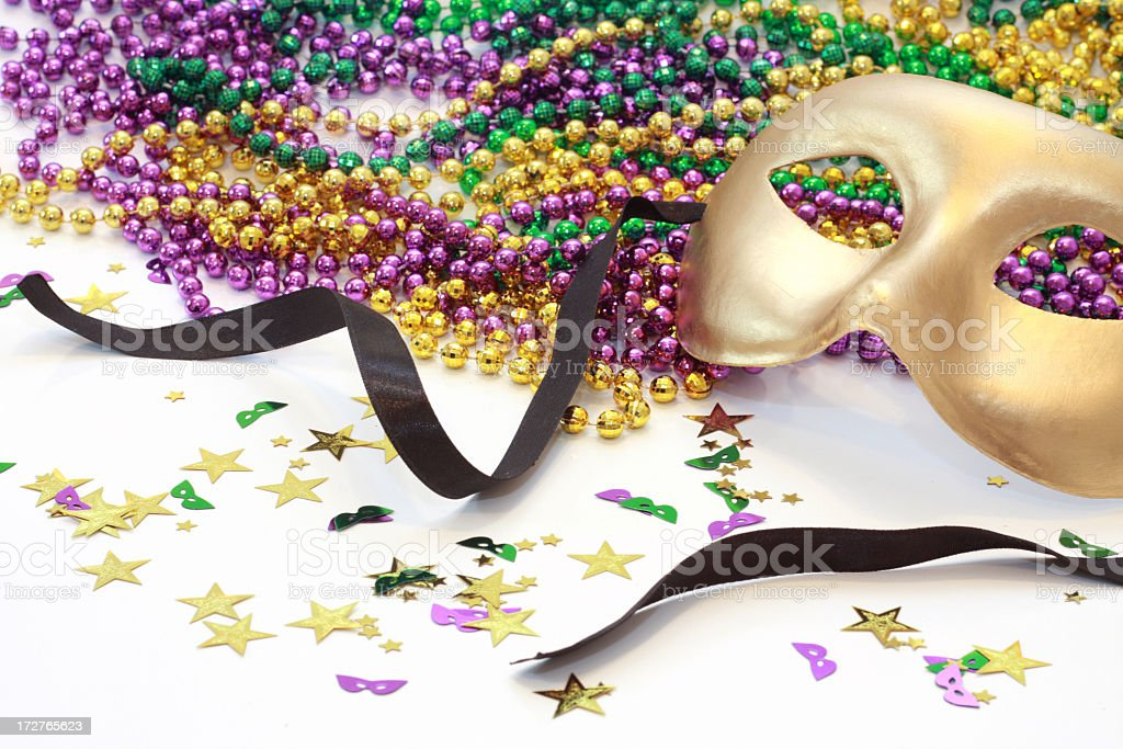 A golden carnival mask and beads royalty-free stock photo