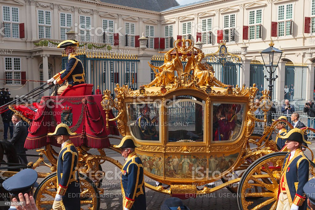 Golden Carriage arriving at Noordeinde Palace in The Hague royalty-free stock photo