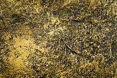 Golden cement wall background and texture