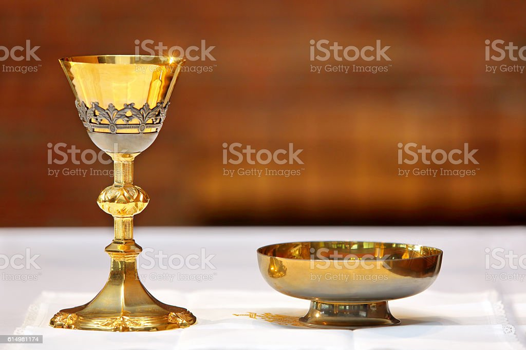 Golden chalice on the altar during the mass stock photo