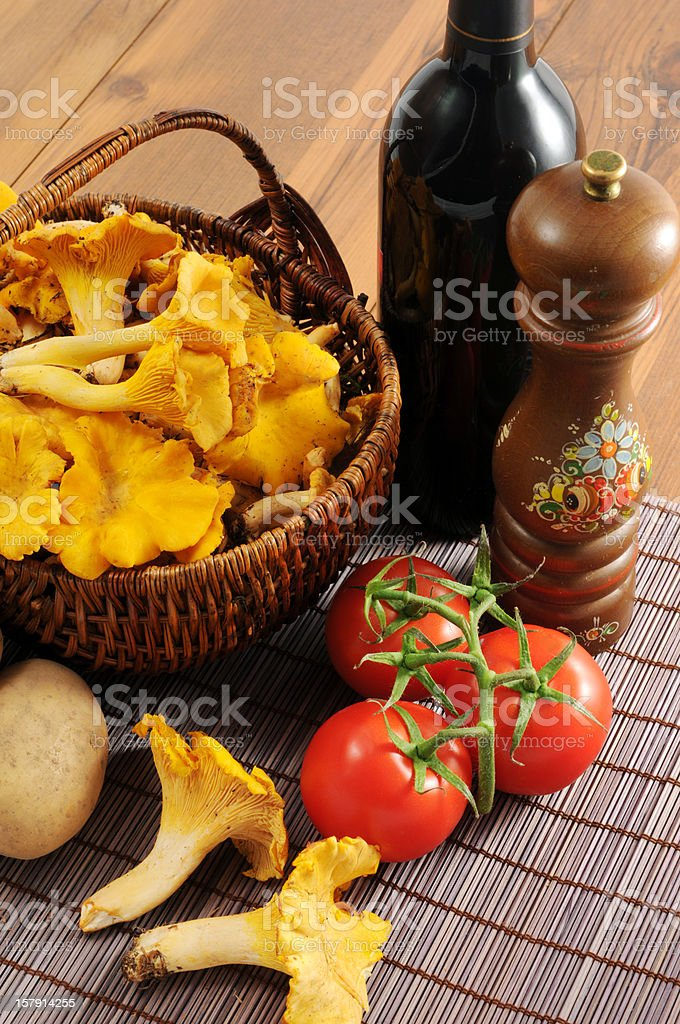 golden chanterelle mushroom (Cantharellus cibarius) with tomates and potatoes stock photo