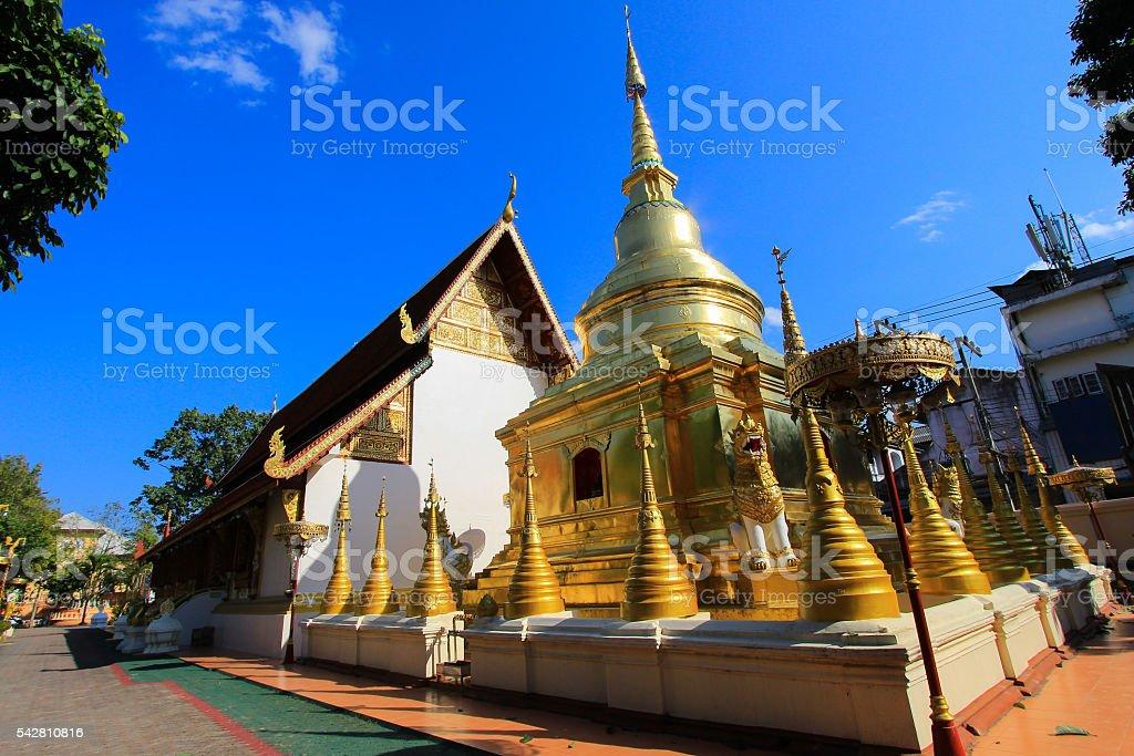 Golden chedi(pagoda) behind the ubosot of Wat Pra Singh stock photo