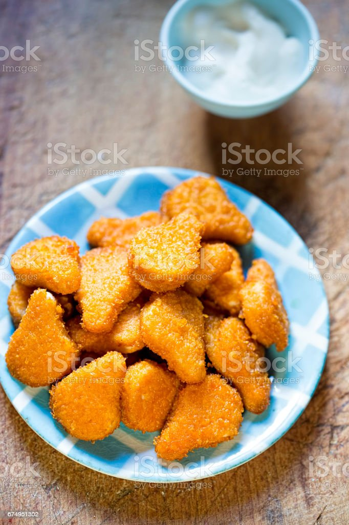 Golden chicken nuggets with mayo dip stock photo