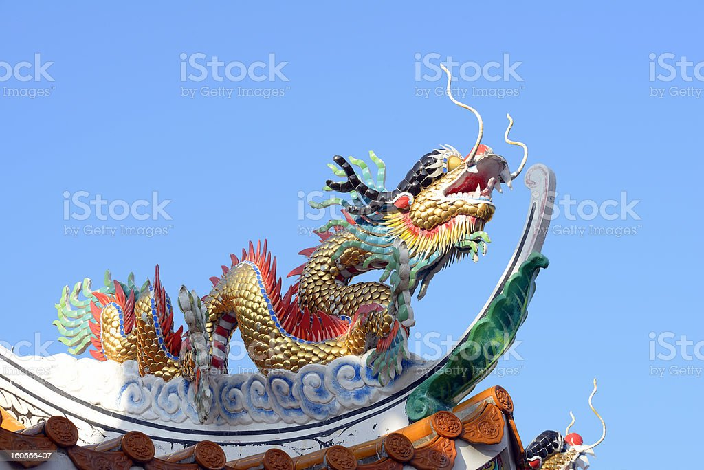 Golden chinese dragon and blue sky royalty-free stock photo