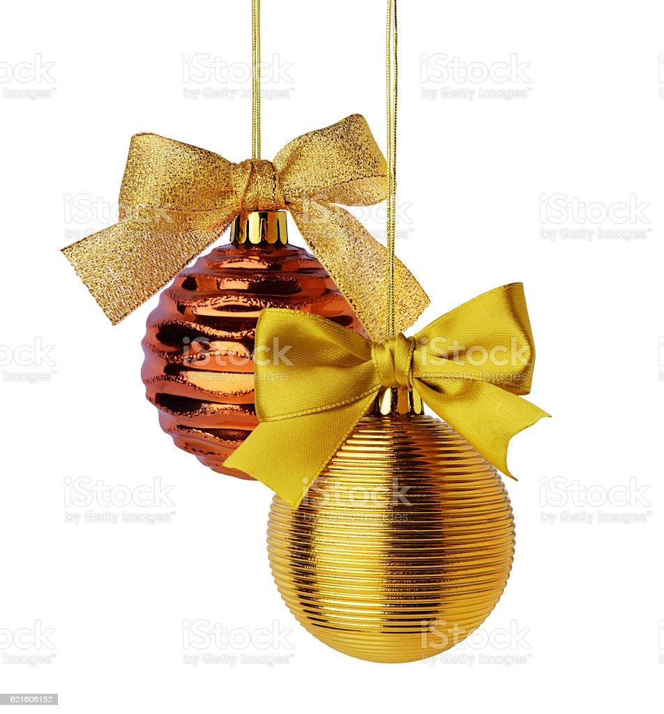 Golden Christmas balls with ribbon bows stock photo