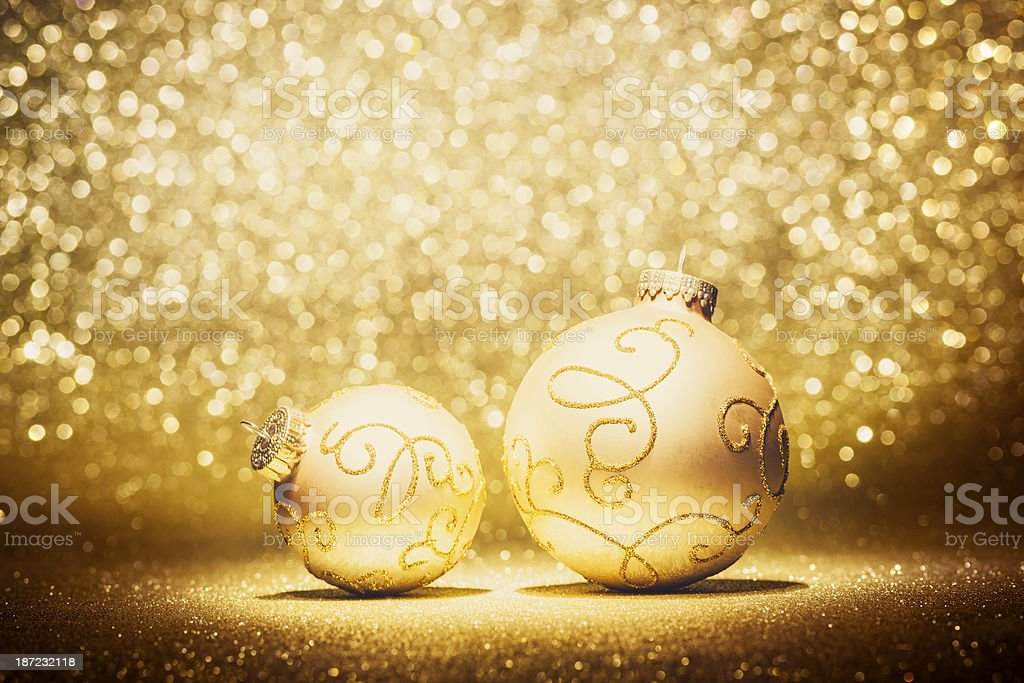 Golden christmas baubles in spotlight royalty-free stock photo