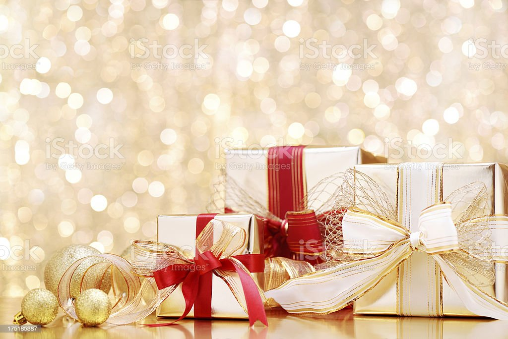 Golden christmas gifts with decoration royalty-free stock photo