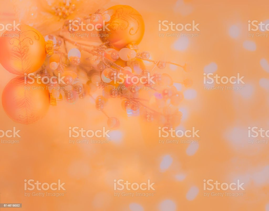 Golden Christmas Ornaments are reflected in peach light (P) stock photo