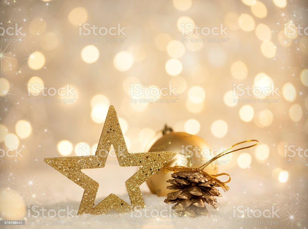 Golden Christmas Scene, Bokeh Lights and Ornaments in Snow stock photo