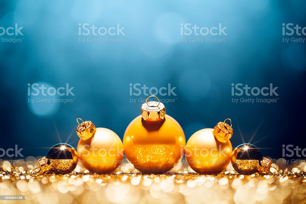 Golden christmas baubles decoration. Defocused lights in the...