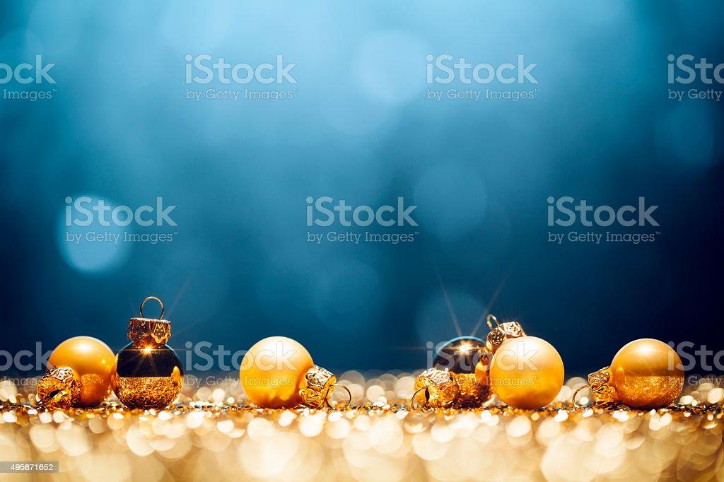 Golden Christmas Time - Decorations Lights Bokeh Defocused Blue Gold stock photo