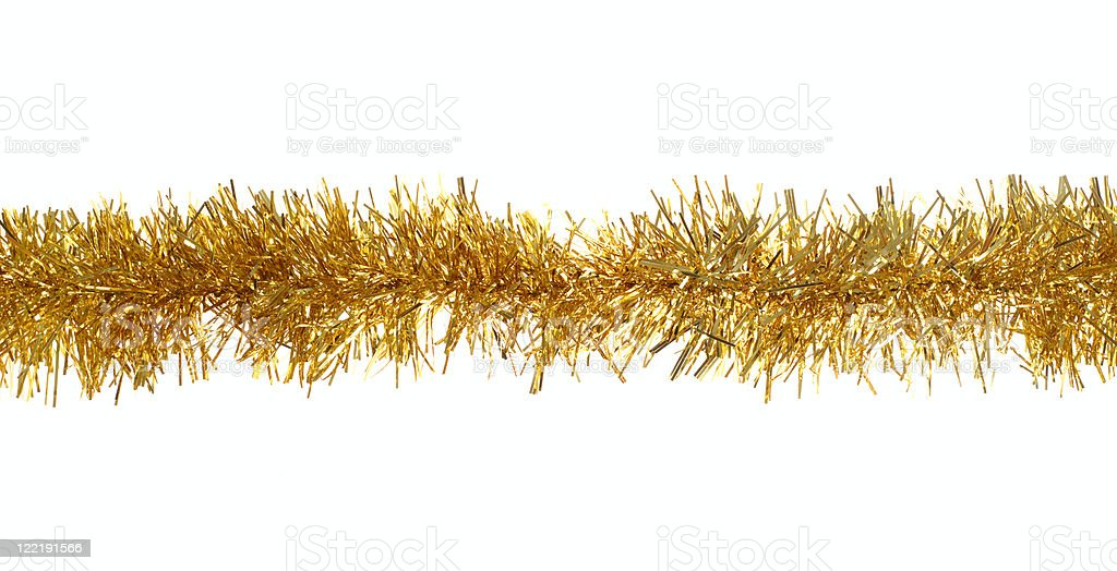 Golden Christmas tinsel over a white background stock photo