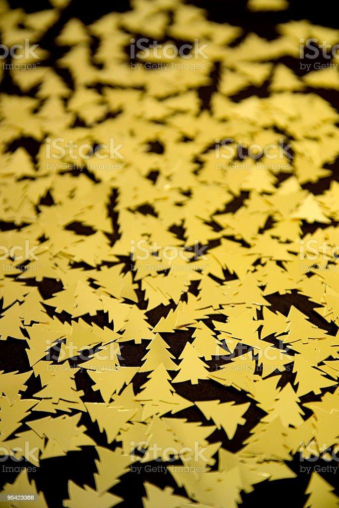Golden christmas tree confetti stock photo